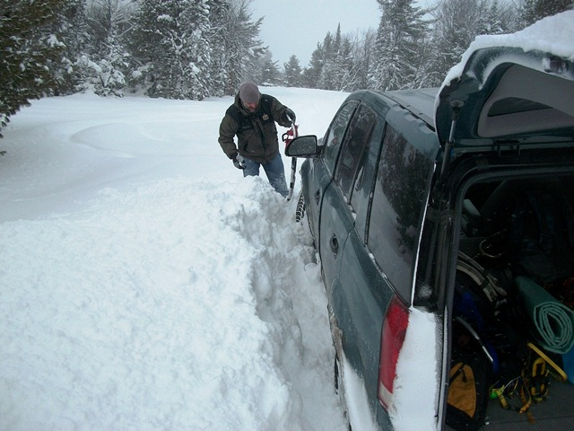 Nate's futile attempt to dig us out with a snowshoe!!