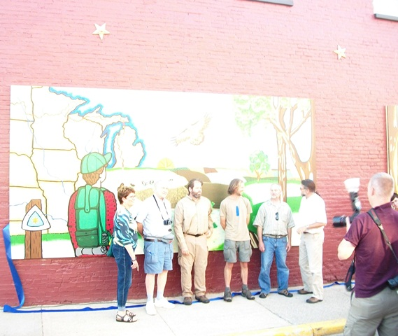 Artists and Luke Jordan in front of Mural